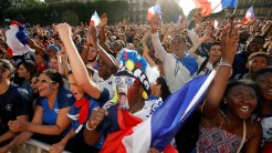 Soccer Football - World Cup - Semi-Final - France vs Belgium - Paris, France, July 10, 2018 - Fans react in a fan zone at the Hotel de Ville before the World Cup semi-final match. REUTERS/Philippe Wojazer